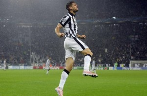 Juventus' Llorente celebrates after scoring against Olympiakos' during their Champions League soccer match at Juventus stadium in Turin,